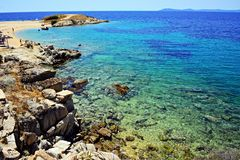 Rocky beach from Toroni island in Greece stock photography