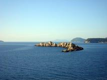 Rocky islands in blue sea Stock Photo