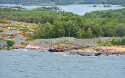 Rocky islands with green forest Royalty Free Stock Photography