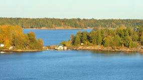 Rocky islands in Helsinki archipelago. Wooden house. Rocky islands in Helsinki archipelago in Finland Stock Photos
