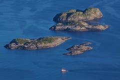 Rocky islands in norwegian sea Stock Photography