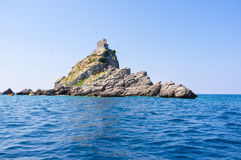 The rocky islet. The Church of Sveta Nedelja located on the rocky island of Mali Katic, next to the coast of Petrovac, Montenegro Royalty Free Stock Photography