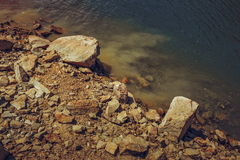 Rocky lake shore Stock Image