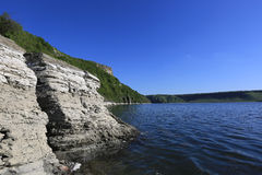 Rocky lake shore in nice day Stock Image
