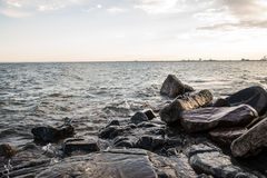 Rocky lake shore. Waves hitting the rocky shore of Lake Superior Royalty Free Stock Photo