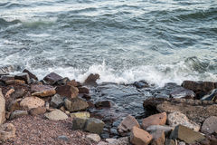 Rocky lake shore. Waves hitting the rocky shore of Lake Superior Royalty Free Stock Image