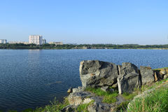 Rocky lake with some stones and grass in the bank. Near Ho Chi Minh city, vietnam Stock Images