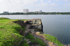 Rocky lake with some stones and grass in the bank. Near Ho Chi Minh city, vietnam Royalty Free Stock Photos