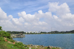Rocky lake with some stones and grass in the bank. Near Ho Chi Minh city, vietnam Stock Photography