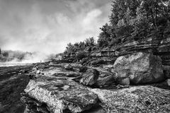 Rocky landscape. Black and white scenic view of rocky landscape with forest and cloudscape background royalty free stock image