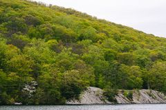 Rocky landscape along Hessian Lake, at Bear Mountain State Park, New York.  royalty free stock photography
