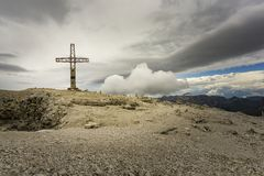 Rocky landscape with a cross on the summit of Sass Pordoi. Dolom. Ites. Italy Stock Image