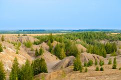 Rocky landscape, green forest and blue sky Stock Photos