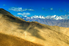 Rocky landscape of Ladakh with blue sky and ice peaks at Changla pass. Rocky landscape of Ladakh with blue sky and ice peaks , brown stones and rocks at Changla Royalty Free Stock Photography
