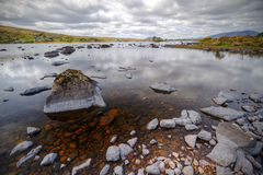 Rocky landscape of lake in Connemara Stock Image