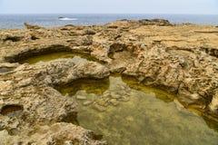 Rocky landscape, Malta. Dwajra Bay, on the coast of Gozo, Malta Stock Images