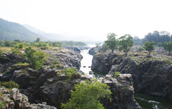 The rocky landscapes at Hogenakkal, Tamil Nadu. The rocky canyons at Hogenakkal, with Cauvery River flowing through them, is a popular tourist spot among locals Stock Photography