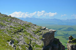 The rocky ledge on a background of mountain. Elbrus Stock Image