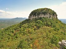 Pilot Mountain State Park Pinnacle. A rocky ledge overlooks the pinnacle under blue skies at Pilot Mountain State Park in North Carolina Royalty Free Stock Photography