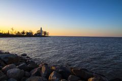 Rocky Lighthouse Coastal Shore In Michigan royalty free stock photos