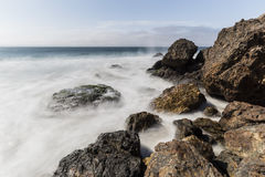 Rocky Malibu California Coast with Motion Blur Water.  Royalty Free Stock Images