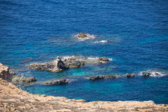 Rocky Malta South Coast at Ras Il-Hamrij. Royalty Free Stock Photo