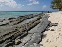 Rocky of Managaha Island shoreline, Saipan Stock Photos