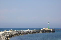 Rocky marina wall in Umag Stock Photography