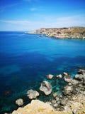 Rocky mediterranean seashore with azure and turquoise color water at Malta. Rocky mediterranean seashore with azure and turquoise color water, Malta, EU stock photos