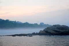 Rocky misty coast Royalty Free Stock Photos