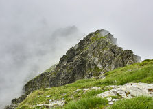 Rocky misty mountains Stock Images