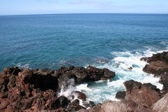 Rocky Molokai Hawaii Coast. Pacific Ocean waves wash the rocky west coast of the tropical island of Molokai Hawaii stock photography