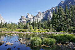 Rocky monoliths. Are reflected in the river Mersed in Yosemite park royalty free stock photos