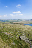 Rocky moorland landscape in Yorkshire overlooking March Haigh reservoir in the Pennines Royalty Free Stock Images