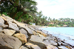 Rocky mound at the shore of the Indian ocean Royalty Free Stock Image