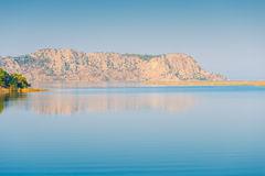 Rocky mountain and calm sea. Seascape, rocky mountain and calm sea Royalty Free Stock Images