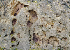 Rocky Mountain Detail. Cracked rocky mountain surface front view photo Stock Photography