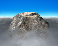 Rocky mountain with Euro shape hilltop. Cloudy and blue sky Royalty Free Stock Photos