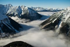 Rocky Mountain With Fog in Daytime Photo Stock Photo