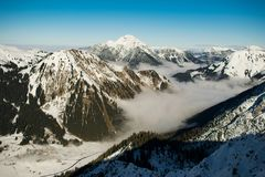 Rocky Mountain With Fog in Daytime Photo Stock Image