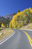 Rocky Mountain Highway in Fall. A highway winds through beautiful colorado rocky mountains in autumn Royalty Free Stock Photography
