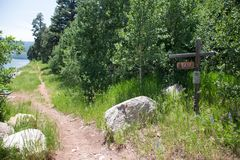 Rocky Mountain Hiking Trail Trailhead with Sign Stock Photo