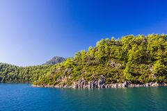 Rocky mountain Islands in the Aegean sea. Seascape with blue sky.  stock photo