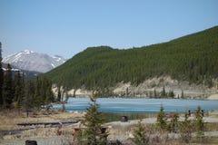 A rocky mountain lake at springtime. Stock Photos