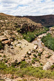 Rocky mountain landscape with dry riverbed Royalty Free Stock Image