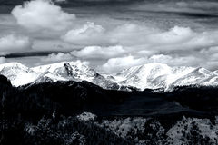 Rocky Mountain National Park. Longs Peak and Mount Meeker covered in fresh snow in Rocky Mountain National Park. Mono tinted with dramatic sky Royalty Free Stock Image