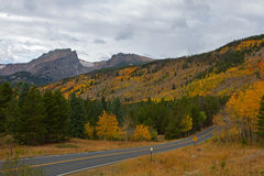Rocky Mountain National Park and Bear Lake Road. Bear Lake road winds up the hillside on an autumn day in Rocky Mountain National Park stock photo