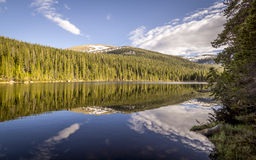 Rocky Mountain National Park Finch Lake. Rocky Mountain National Park Colorado Continental Divide Finch Lake hiking backpack forest summer shoreline clouds stock photo