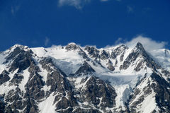 Rocky mountain peak covered with snow Stock Images