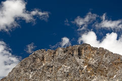Rocky mountain peak under blue sky Stock Photo